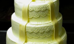 Wedding gown cake ivory champagne lace ribbon bow