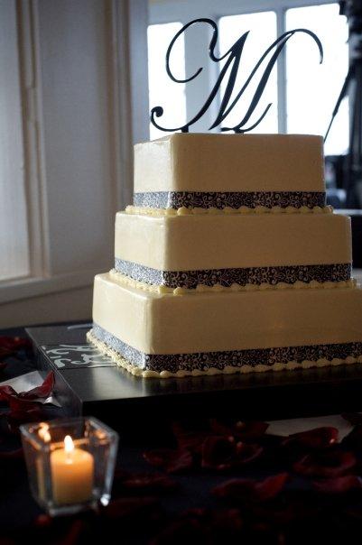 Square three tiered black ribbon wedding cake